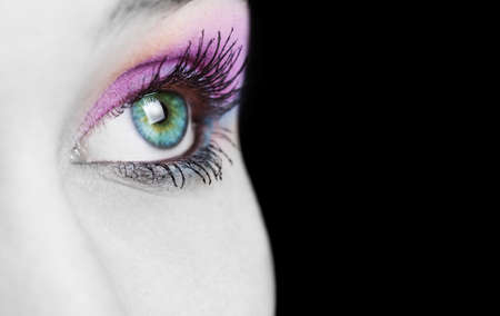 Close up on female eye with colorful makeup