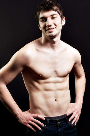 Shirtless sexy man with muscular abdomen over black Stock Photo - 7018509