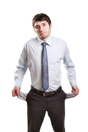 broke: Sad and broke business man with empty pockets Stock Photo