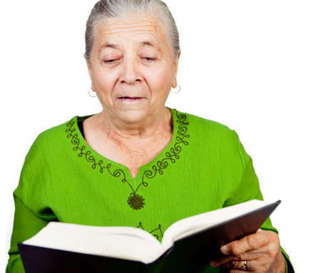 Amazed old lady reading big info book photo