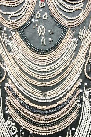 Many shiny decorative jewels at souvenir market Stock Photo - 7342044
