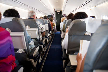 Interior of airplane with passengers on seats Stock Photo - 7342042