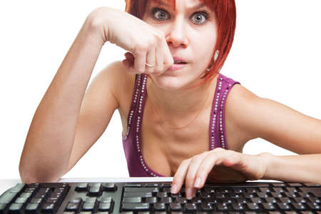 Angry woman on computer surfing the web photo