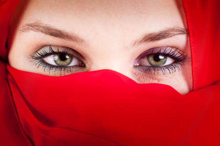 Red veil woman with beautiful sexy eyes photo