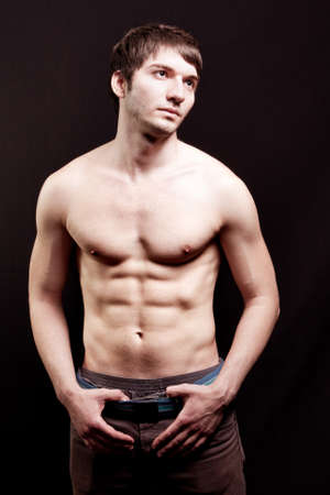 bare chest: Shirtless young guy with sexy abs over black
