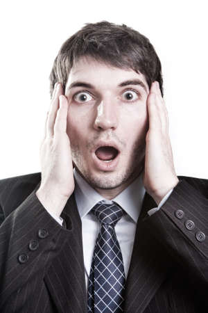 is astonished: Isolated businessman with surprise expression on his face Stock Photo