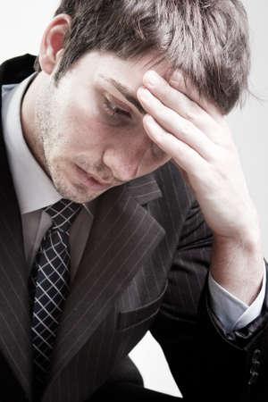 Portrait of depressed sad tired business man
