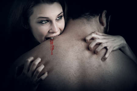 erotic fantasy: Love and blood story - vampire woman biting her lover