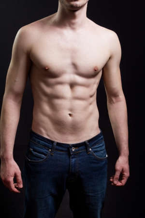 Nice abdomen of man with muscular sexy body photo