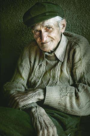 Artistic portrait of old senior man with wrinkled hands 写真素材