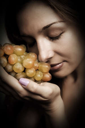 Healthy nutrition - woman with fresh grapes in her hand photo