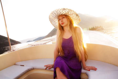 Beautiful elegant blond woman on luxury boat photo