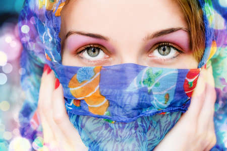 Vibrant portrait of woman with beautiful eyes and scarf