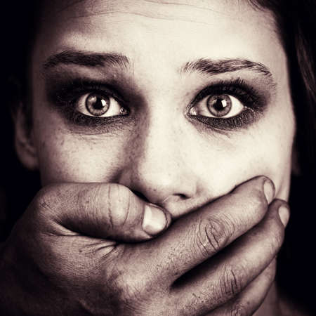 Scared woman victim of domestic torture and violence