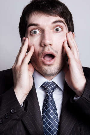 Funny portrait of amazed young business man Stock Photo - 7941255