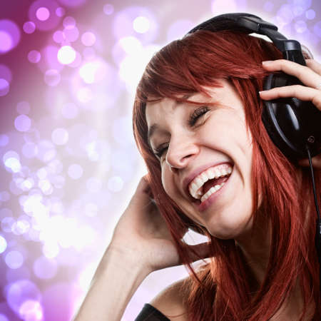 Happy young woman having fun with music headphones photo