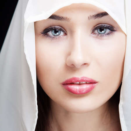 Face of beautiful woman with sensual eyes and lips photo