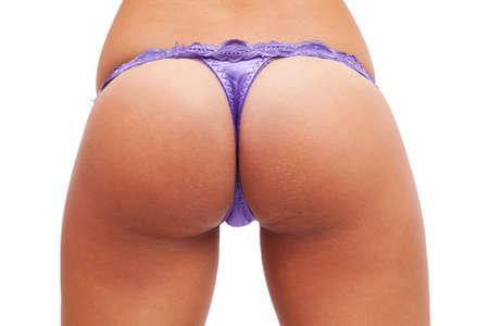cintura perfecta: Detalle de culo femenino y caderas aislados en blanco  Foto de archivo