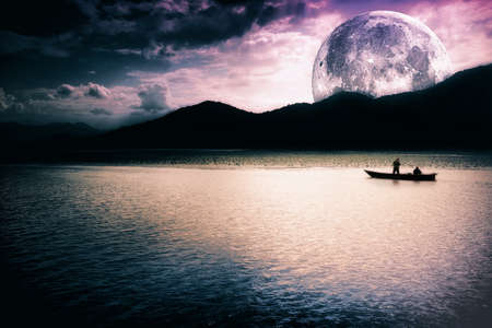 Fantasy landscape - moon, lake and fishing boat photo