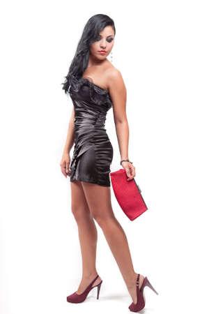 full red: Ritratto di moda di elegante sexy brunette woman Archivio Fotografico