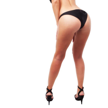 Sexy female body - ass and legs isolated on white Stock Photo - 8305718