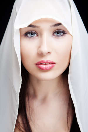 Face of sensual young woman with beautiful eyes photo