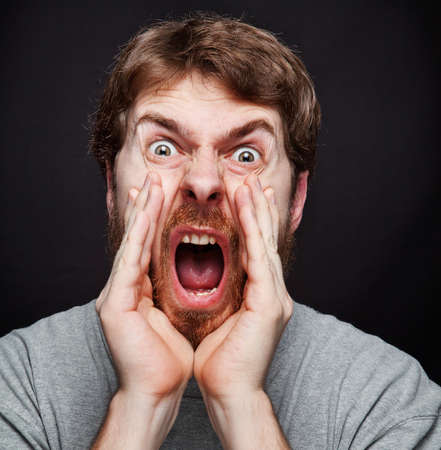 making an announcement: Scream of excited man making an announcement Stock Photo