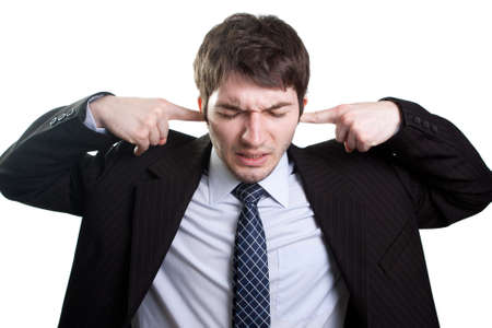 Isolated businessman expressing stress and noise concept Foto de archivo