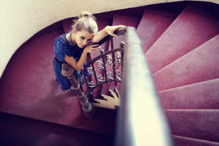 Artistic portrait of elegant woman on circular stairway photo