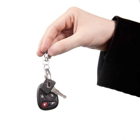 Neue Auto-Konzept - Hand und Schlüssel, isoliert auf weiss