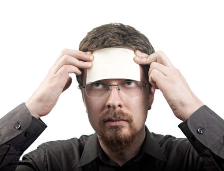 post card: Man with blank note over his forehead isolated on white Stock Photo