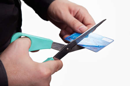 Cutting debts concept - scissors and credit card over white Stock Photo - 8880863