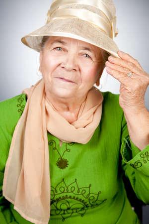 Studio portrait of happy old senior woman photo