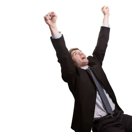 Win and success concept - victorious young businessman photo