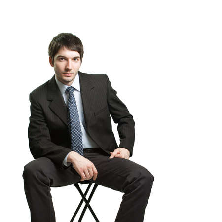 Confident businessman sitting on chair over white photo