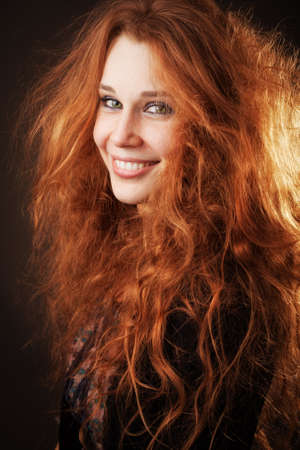red head girl: Young woman with beautiful long fluffy hair