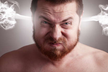 constipated: Stress concept - angry frustrated man with exploding head Stock Photo