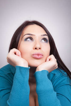 daydream: Daydream concept - pretty wishful woman thinking about something nice Stock Photo