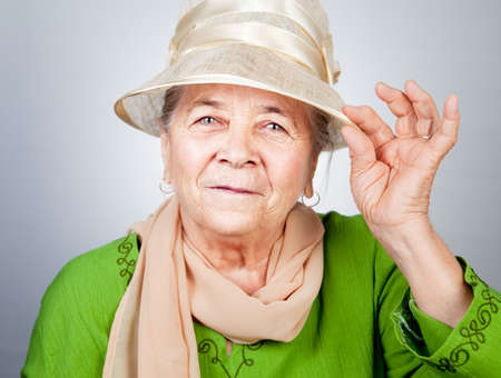 Happy joyful old senior lady in elegant nice clothes photo