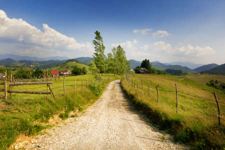 Rural landscape from Romania - village road and grassland Stock Photo - 10059771