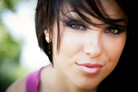 Face of cute young brunette woman