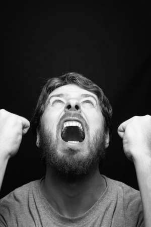 Scream of angry rebel man over black Stock Photo - 11130974