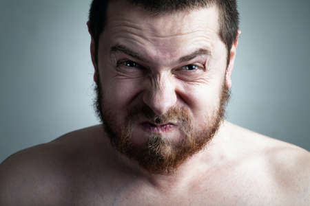 tantrum: Stress or constipation concept - man with funny grimace Stock Photo
