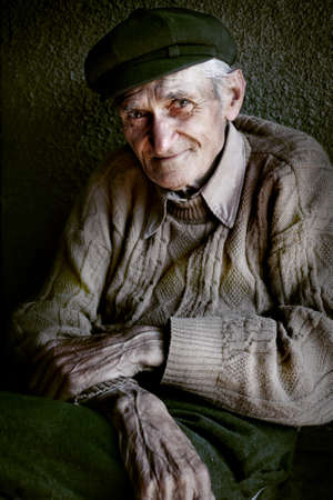 Content senior old man with expressive eyes photo