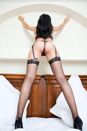 Woman in Strümpfen mit sexy Hintern und lange Beine