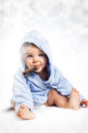 cigar smoke: Smoking addiction concept - child puffing a cigar over white Stock Photo