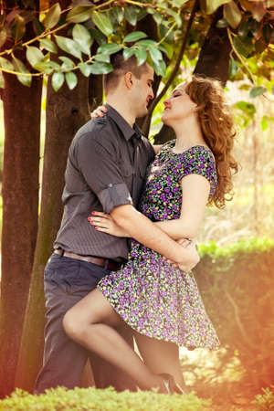 Romantic young lovers hugging with passion outdoor photo