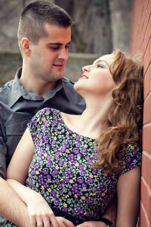 Sensual couple hugging outdoors with passion photo