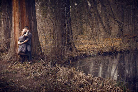Young happy couple hugging with passion outdoors photo