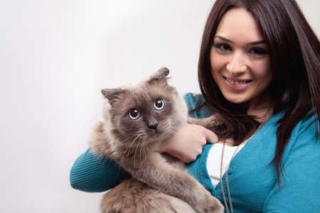 Cute woman and funny cat over white